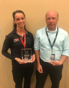 (L-R) Manager Melanie Gamble of Chickie's & Pete's Concourse A-West and General Manager Chris Matterson from Stellar News Concourse F accepting their trophies